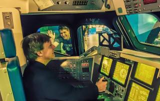 chuck pell at controls of space shuttle simulator