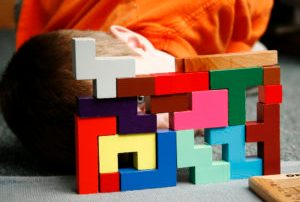 boy looking through montessori blocks colorful creative success