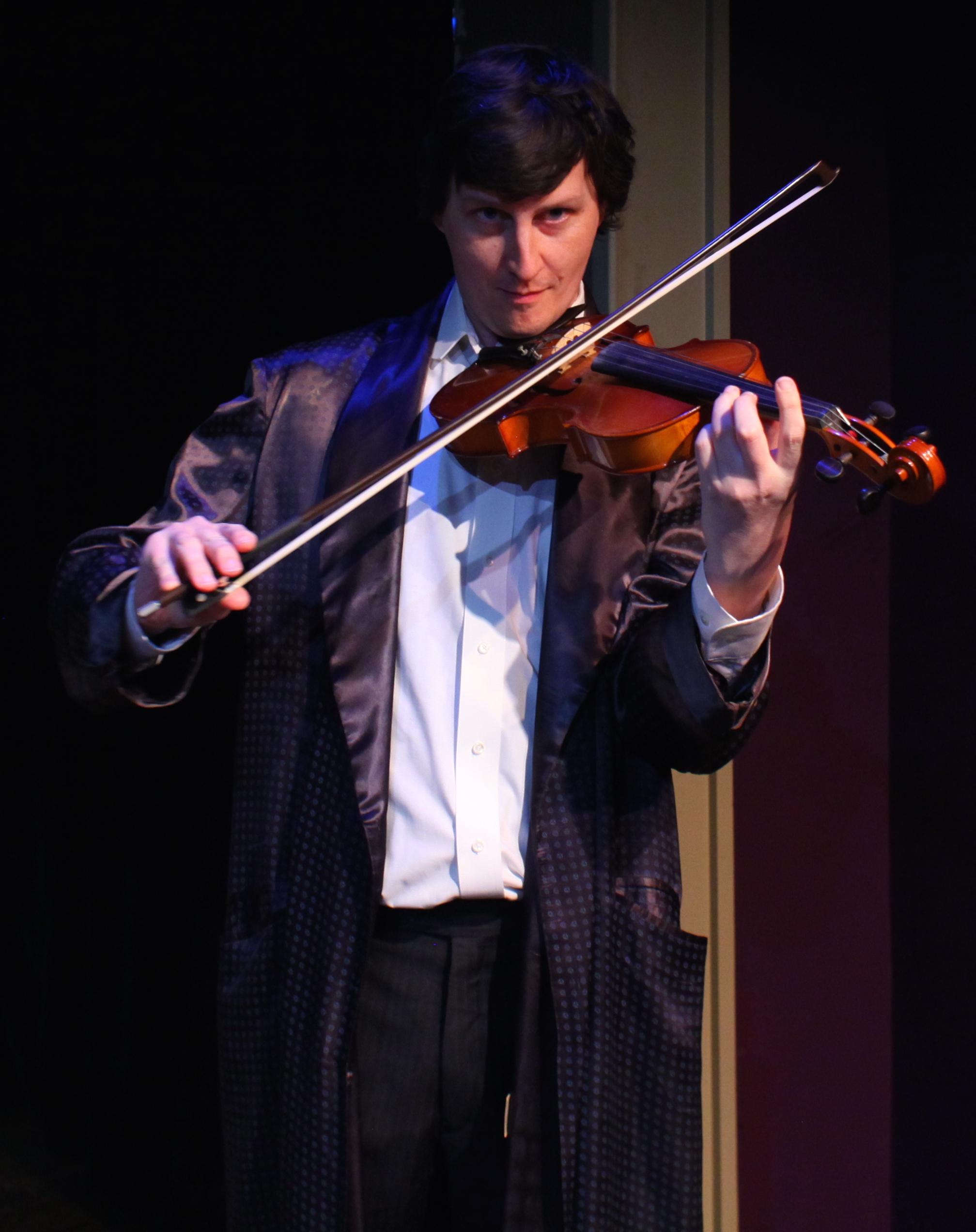 Sherlock Holmes (Matt Sims) with violin