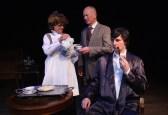 Mrs Hudson serves tea - Mrs. Hudson (Barbara Turner), Dr Watson (Paul Noga), and Sherlock Holmes (Matt Sims)