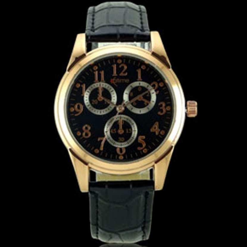 montre homme elegante avec boitier dore et bracelet cuir noir