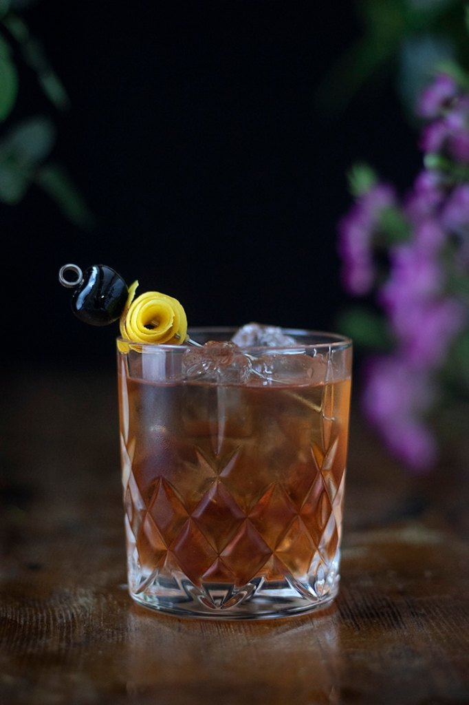 sazerac-classic-cocktail-with-cherry-and-lemon-twist