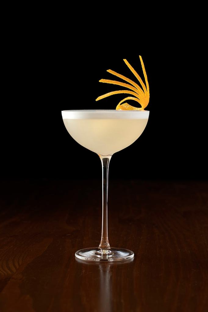 white-lady-cocktail-with-citrus-peel-fan-garnish-3986452
