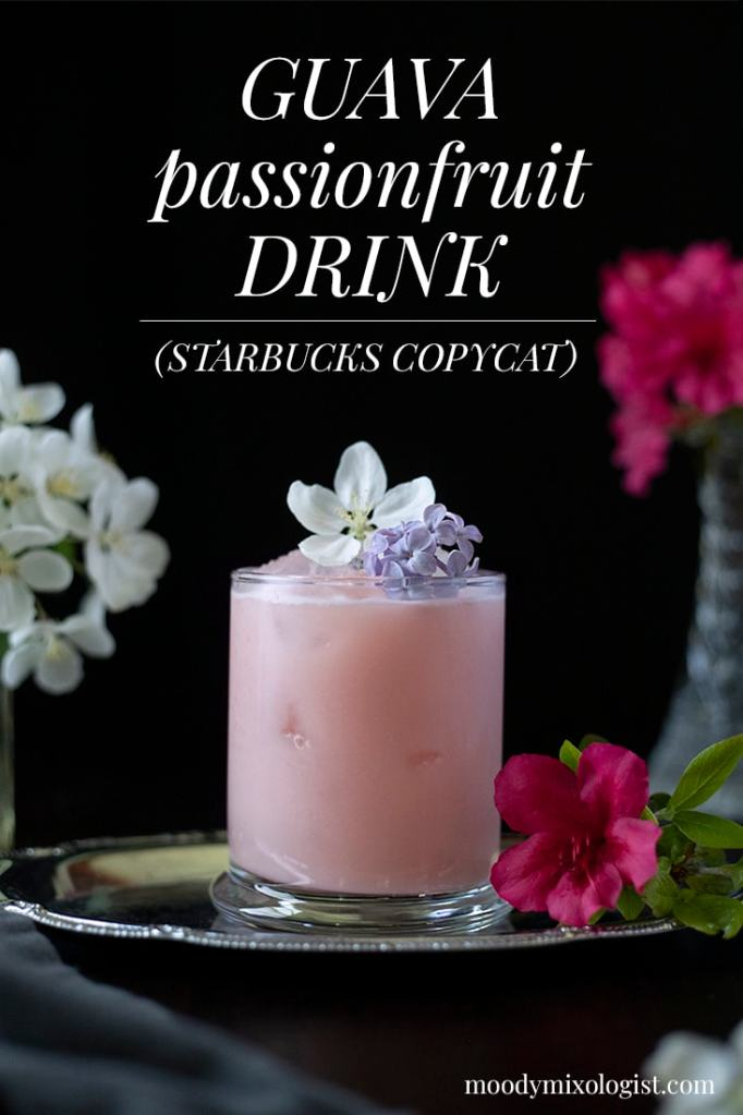 a pink drink in a rocks glass with flowers an the text about Guava Passionfruit Drink Starbucks Copycat