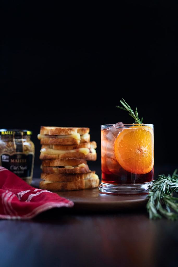 jar of mustard next grilled cheese stack and cocktail