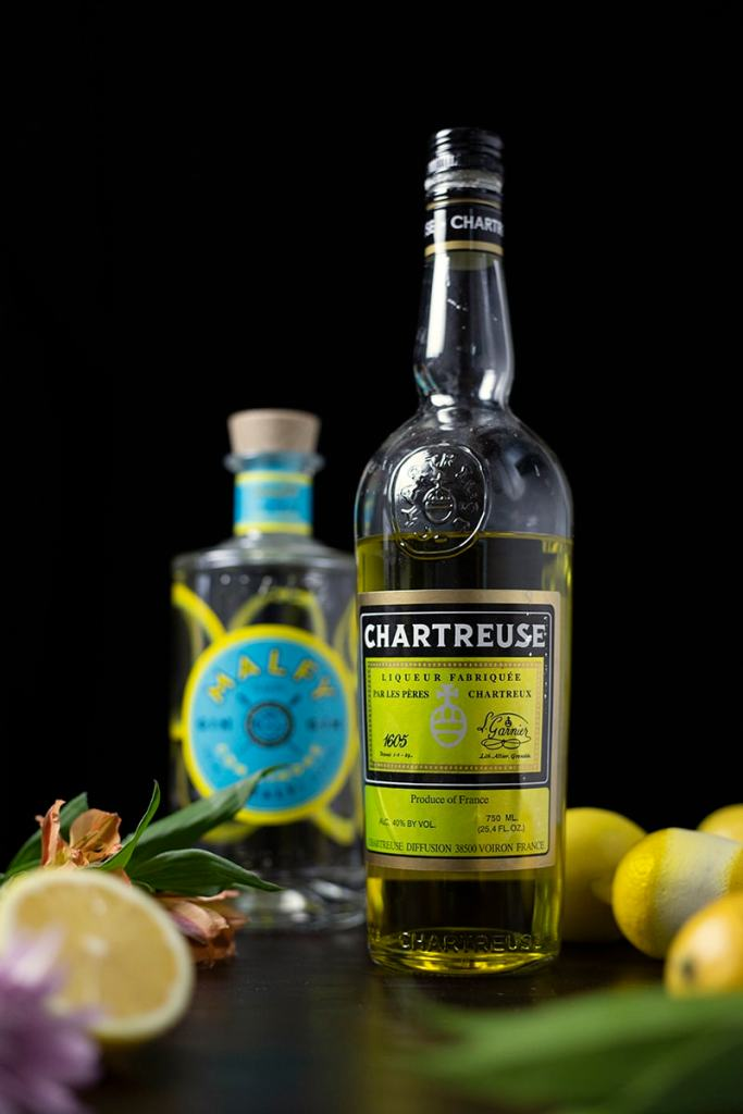 bottle of Yellow Chartreuse next to a bottle of Malfy Gin
