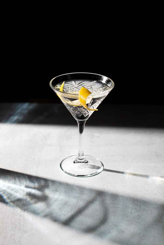 a martini on a gray table.