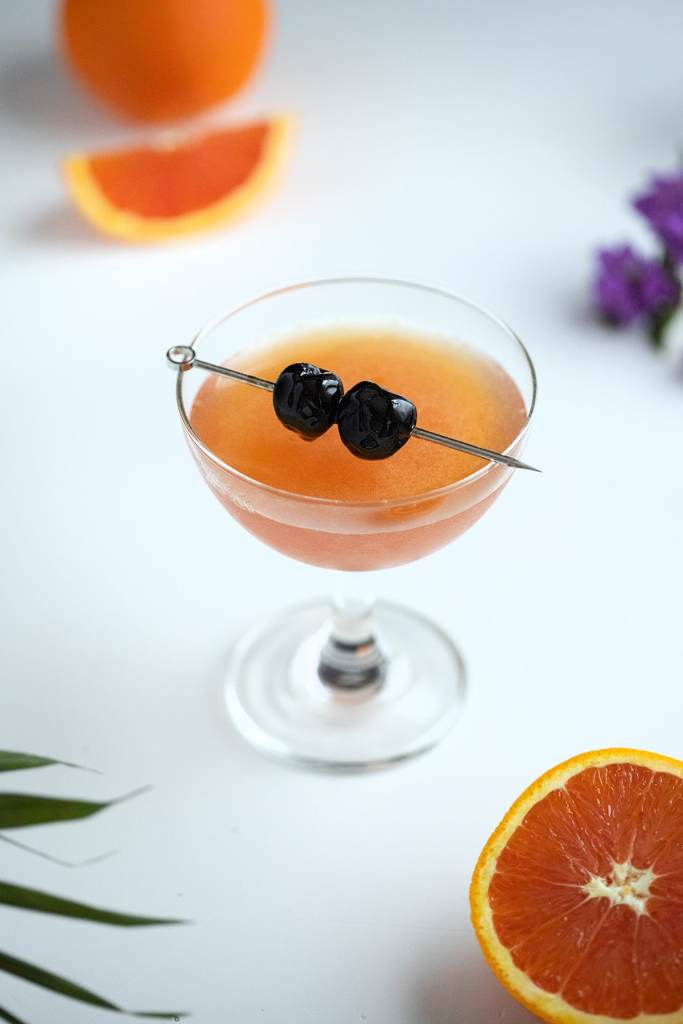 ward eight cocktail with orange slices.