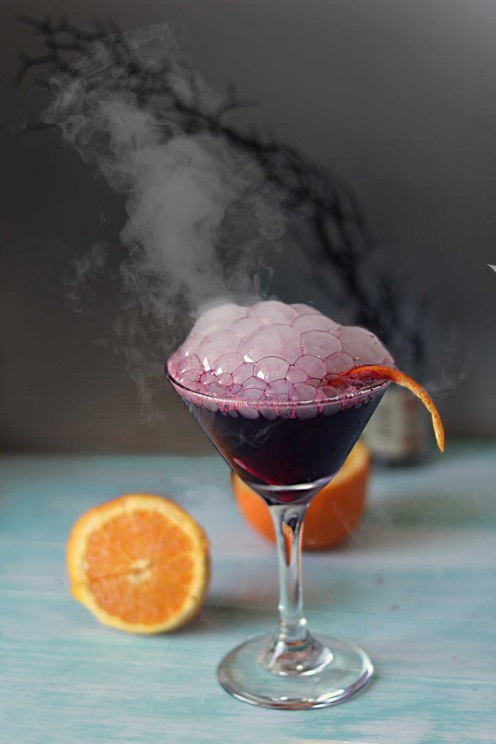 Bloody witch's brew black magic martini. Perfect for Samhain or Halloween.