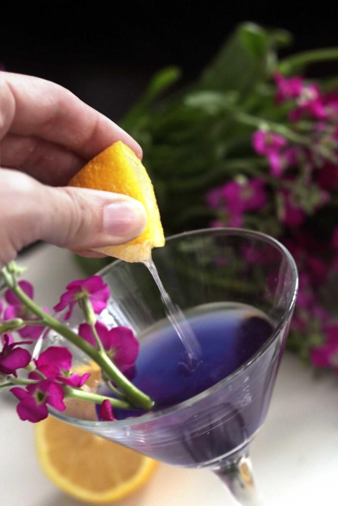 A splash of tart lemon balances this purple fairy floral cocktail.