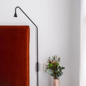 Austere wall sconce