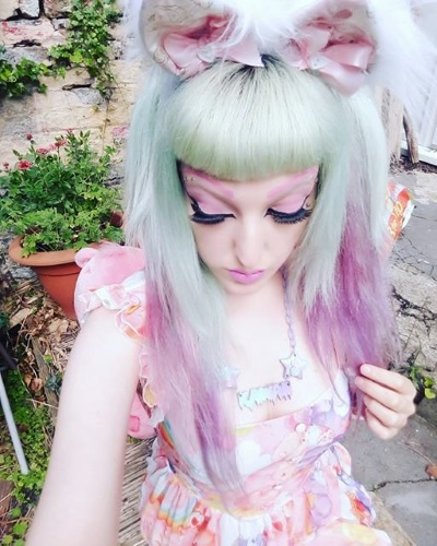 pastel goth clothing plastic and bows cat ears