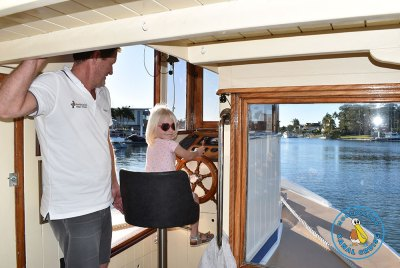Children Steering the boat - Mooloolaba Canal Cruise
