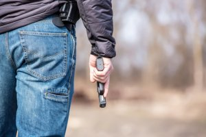 Close-Up of Man Holding .45 Caliber Handgun