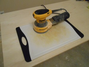Use an orbital sander on your cutting board