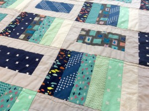 Blue gray modern quilt close piecing detail 2