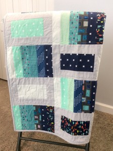 Blue and Gray quilt hanging