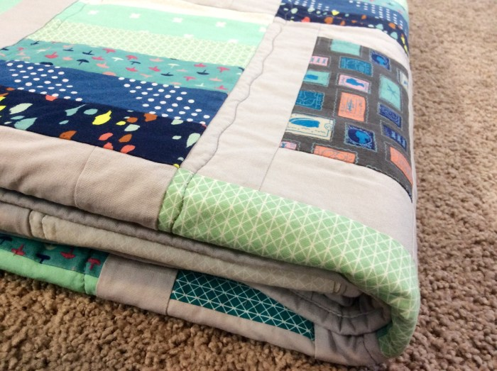 Blue gray modern quilt folded close up