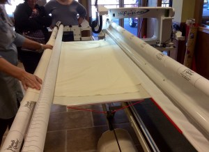 Handi Quilter longarm quilting machine loading top