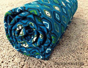 Moore Approved Connecting Threads Flannel Blue Blanket Rolled Up