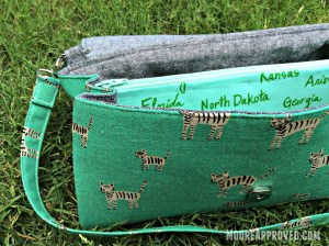 Swoon Glenda Convertible Clutch Cotton and Steel Canvas Teal Metallic Tigers Print Robert Kaufman Yarn Dyed Essex Linen Black Front Side View
