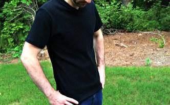 Jalie Tshirt Pattern 2918 James Moore modeling black vneck shirt outdoors full shot looking away