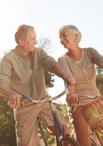 Retired Couple Riding Bikes - Retirement Planning Services