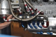 This five-stage oil pump (four scavenge, one pressure) has fine mesh screens embedded in the fittings at the ends of the number 12 lines to minimize the risk of particles entering the pump. But in the aftermath of a blow-up fine debris usually penetrates to the heart of the system, and the lines and pump parts have to be cleaned and the rotors buffed smooth if necessary. Each of the four scavenge pumps conveys oil from assigned areas of the oil pan and transports it into the oil reservoir. The pressure pump (the one at the end) pumps oil from the bottom of the reservoir and into the filter. From the filter it is transported into the block.