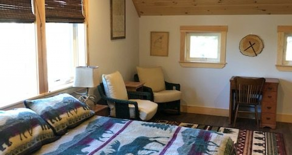 Bedroom 2 with Sitting Area and View to Moose River