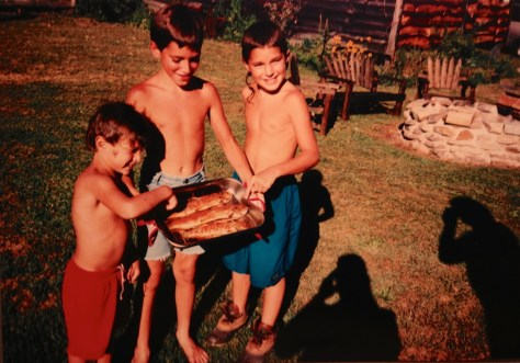 1994 - Christopher, Brenton and Little Mike demonstrate the Trout they caught. Credit to Big Mike for his culinary skills.