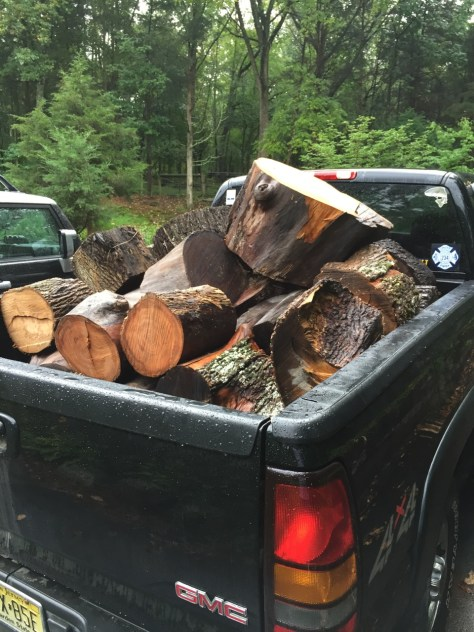 A sign of the fall, pickups loaded down with wood.