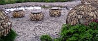 large round spheres dot this shale grey water landscape