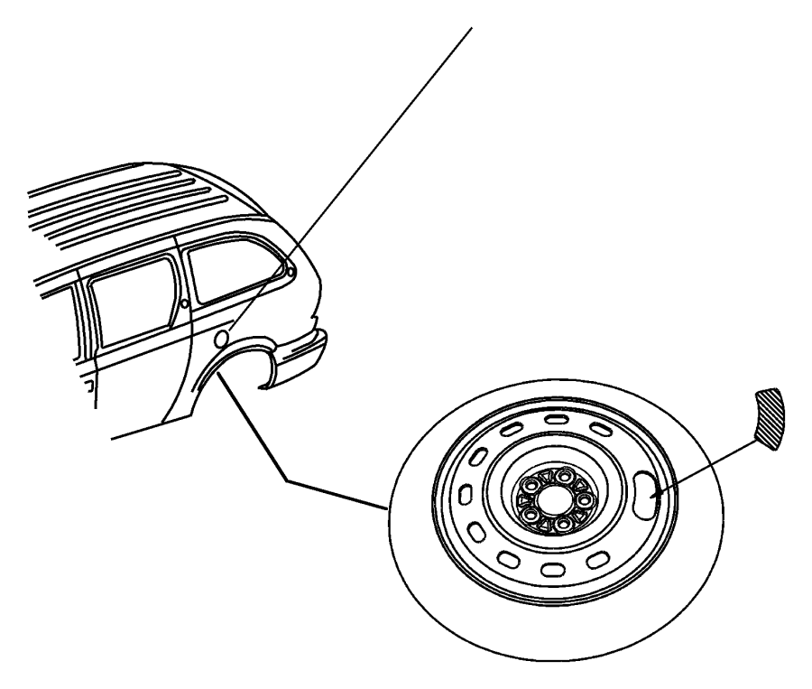 Chrysler Town & Country Label. Spare tire storage. Compact