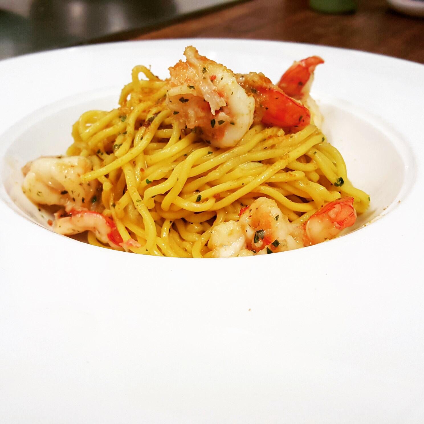 Homemade tagliolini with lemon, prawns and bottarga