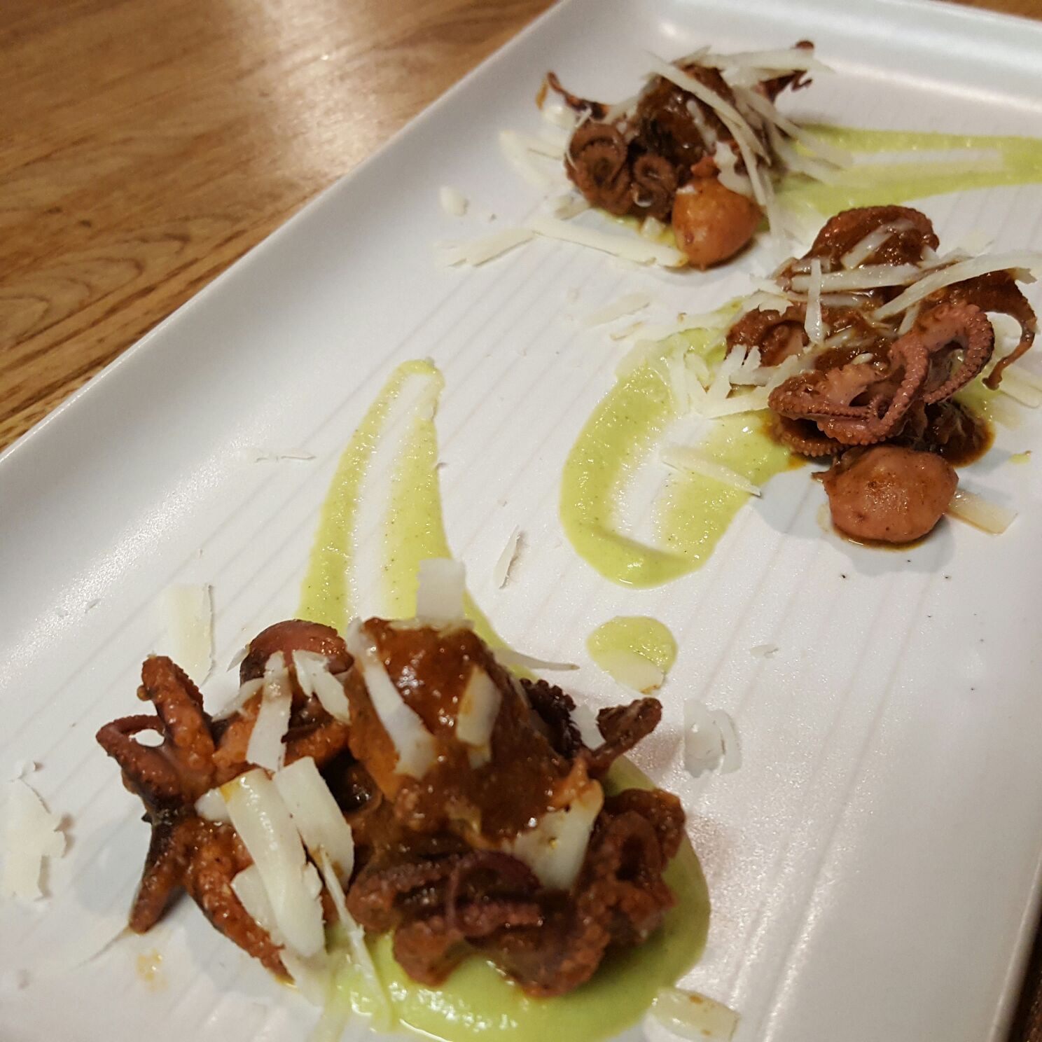 Baby octopus, cream of courgettes and pecorino shavings