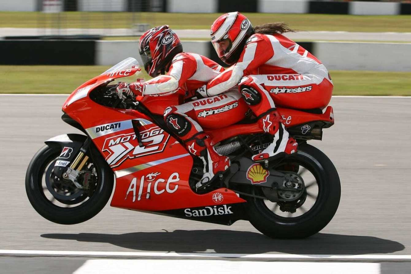 Ross-Noble-on-Ducati-two-seater-Randy-Mamola-pillion-