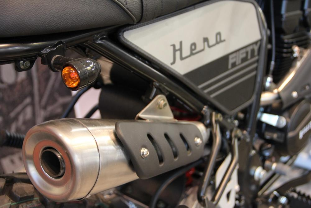 The detailing on the motorcycle, especially around the exhaust and bodywork, is spot on.