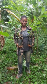 ATSU DAUGHTER HOLDING  SOME OF THEIR SEEDLINGS
