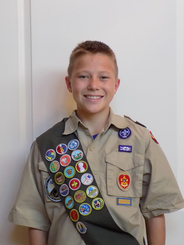 Liam in his uniform with his merit badges