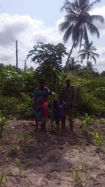 mensah-kportorgbui-family-standing-with-one-of-their-trres