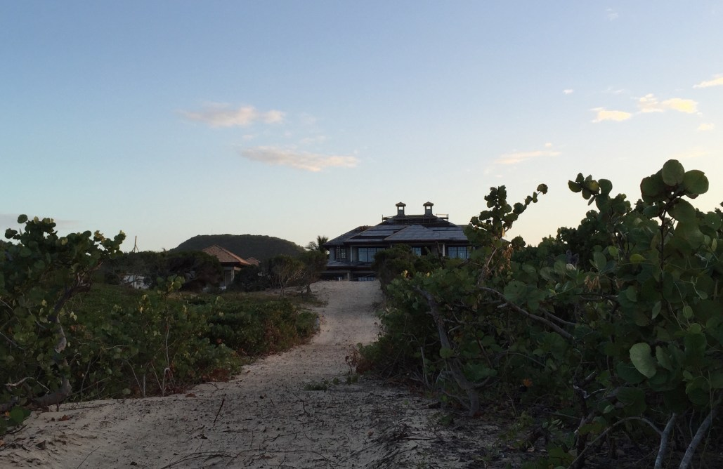 Exterior view St. Kitts project by MMA , as seen from the beach's sandy dunes.