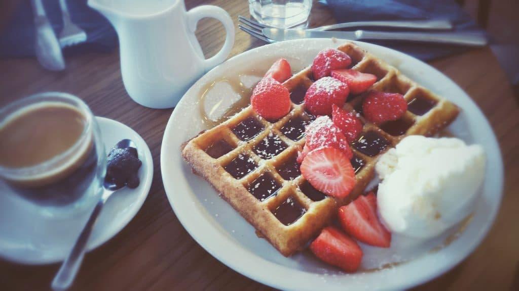 Walfel breakfast with strawberries and coffee.