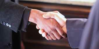 Real Estate Marketing getting to the deal with a handshake