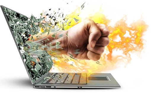 a fist punching out of the screen of a computer.