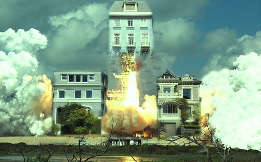 House blasting off with a rocket out from the other two houses by it.