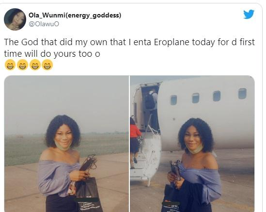 Nigerian lady celebrates while flying on a plane for the first time