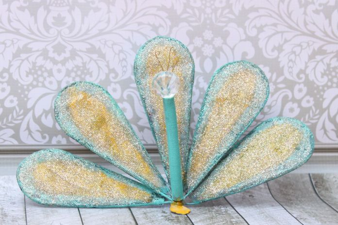 Turn a whisk into fun DIY peacock garden art.