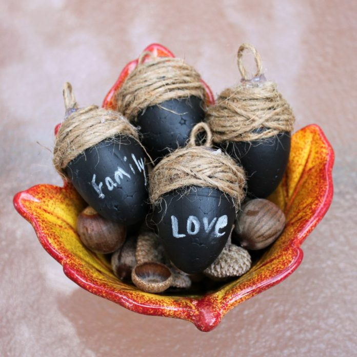 Use chalkboard paint to create create large acorn place cards for your fall table!