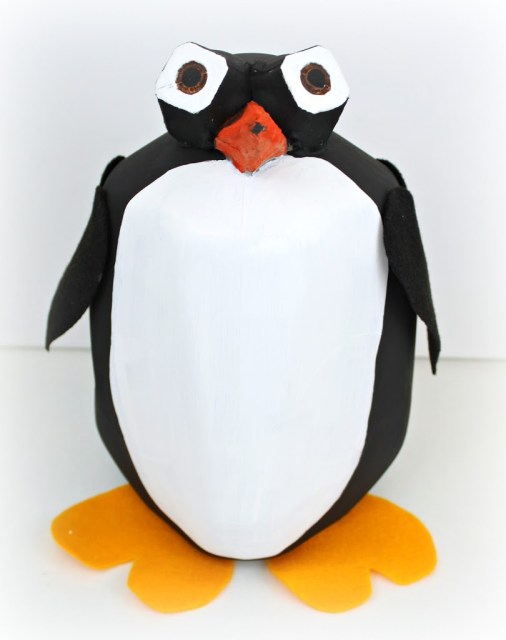 Turn a plastic milk carton into a penguin shaped valentine card holder.