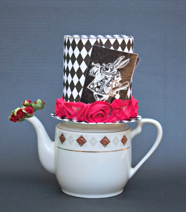 Create delightful Alice in Wonderland inspired art with this whimsical Mad Hatter teapot decor project. This cute piece can also be used for storage.